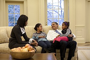 President Barack Obama relaxes on a sofa in th...