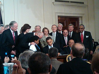 President Barack Obama signing the Patient Protection and Affordable Care Act into law at the White House on March 23, 2010 Obama signing health care-20100323.jpg