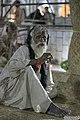 Old man smoking - Tomb of Lal Shahbaz Qalandar.jpg