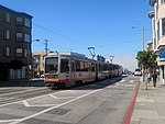 Outbound train at Taraval and 26th Avenue, September 2017.JPG