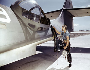 Naval Air Station Corpus Christi - Aviation Ordnanceman stationed at the Naval Air Station Corpus Christi boarding a PBY Catalina, circa 1942