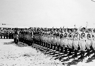 Philippine Constabulary - Members of the First Regiment swearing to the U.S. Flag and to the cause of the United Nations. February or March 1942.