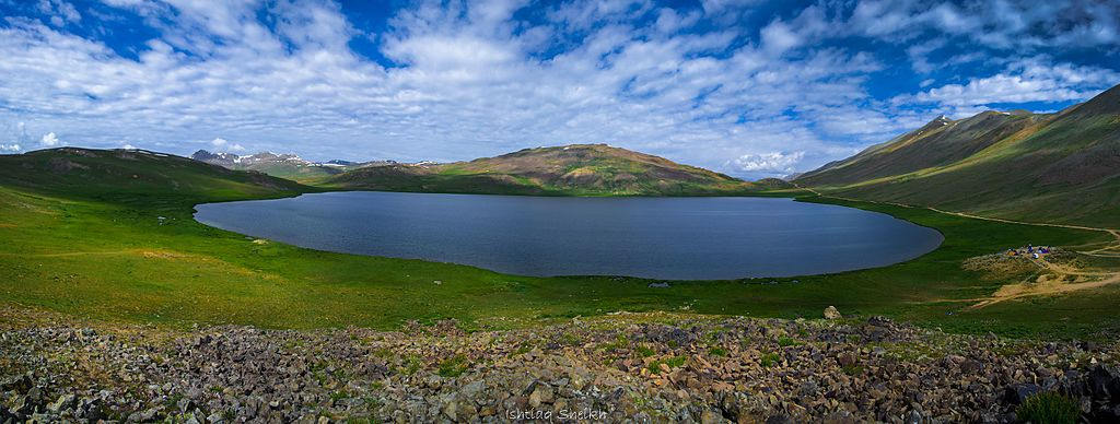 Photo by: Ishtiaq Link: https://commons.wikimedia.org/wiki/File:Panorama_of_Sheosar_Lake,_Deosai_National_Park,_Skardu,_Gilgit_Baltistan,_Pakistan.jpg