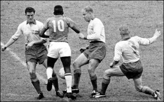 Pelé - Pelé (number 10) dribbles past three Swedish players at the 1958 World Cup.