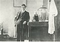 Percy Cartwright standing in his laboratory, c.1912.jpg