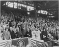 Photograph of President Truman throwing out the first ball to launch the 1952 baseball season, at Griffith Stadium in... - NARA - 200367.tif