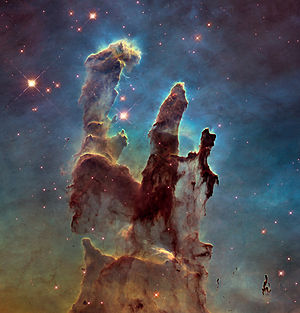 Radiation pressure - The Pillars of Creation clouds within the Eagle Nebula shaped by radiation pressure and stellar winds.