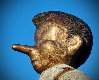 Lie - Close-up of the bronze statue depicting a walking Pinocchio, named Walking to Borås by Jim Dine