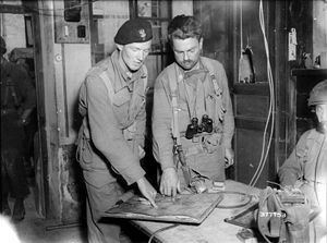 90th Infantry Division (United States) - Lieutenant Klaptocz of the 1st Polish Armoured Division and American officer (Major Leonard C. Dull) from the 359th Infantry Regiment, 90th Infantry Division, after the junction of the two units, Chambois, August 1944