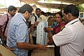 Polling officials checking Electronic Voting Machine (EVM) and other necessary belongings for use in the General Elections-2014, at the distribution centre, at Thycaud, Thiruvananthapuram, Kerala on April 09, 2014 (1).jpg