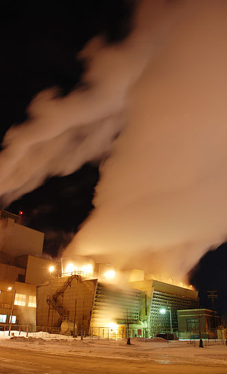 Ames, Iowa - City power plant at night blows steam into the air.