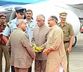 Pranab Mukherjee being received by the Governor of West Bengal, Shri M.K. Narayanan and West Bengal MIC, Public Health Engineering and Panchayat & Rural Development, Shri Subrata Mukherjee, on his arrival.jpg