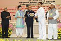 Pranab Mukherjee presenting the National Award for outstanding Services in the field of Prevention of Alcoholism and Substance (Drug) Abuse-2013 to the Gram Panchayat, Chharba, Vikas Khand- Sahaspur, Tehsil - Vikasnagar.jpg