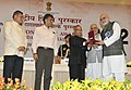 Pranab Mukherjee presenting the Rajat Kamal Award for Best Film on Social Issues Behind the Mist (Malyalam), in Non Feature Film Section to the Producer & Director, Shri Kambrath, at the 60th National Film Awards function.jpg