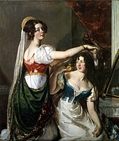 Two young women in elaborate clothing