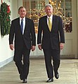 President Bill Clinton and President-Elect George W. Bush walk along the White House colonnade to the Oval Office (1).jpg