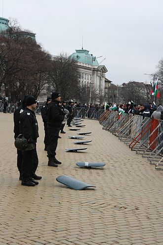 2013 Bulgarian protests against the first Borisov cabinet - Riot police in front of the National Assembly, shields down in a sign of solidarity with the protests