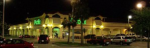 Standalone Publix in Pompano Beach, Florida, with typical architecture of early-21st-century stores.