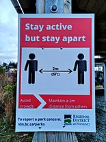 A sign encouraging social distancing in Nanaimo, British Columbia