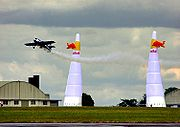 Air racing at an air show in England: the Red Bull Air Race heat held at Kemble Airfield, Gloucestershire. The aircraft fly singly, and pass between pairs of pylons