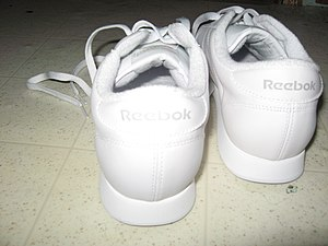 English: The back of a pair of white Reebok Pr...