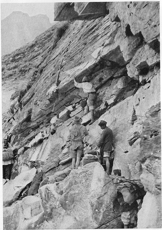 "Shipton-Tilman 1934 Nanda Devi Sanctuary expedition. ""Hauling loads below 'Pisgah'"" buttress in the Rishi Ganga gorge Rishi Ganga gorge - Shipton-Tilman team climbing buttress.jpg"