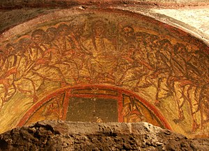 Catacombs - Jesus and his twelve apostles, fresco with the Chi-Rho symbol <big>☧</big>, Catacombs of Domitilla, Rome.