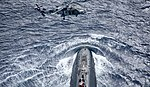 Royal Navy Trafalgar-class submarine HMS Trenchant and Royal Navy Wildcat HMA2 (2).jpg