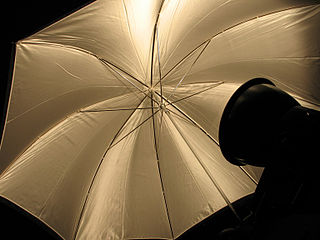 Reflector (photography) reflective surface used to redirect light towards a given subject or scene, used in photography