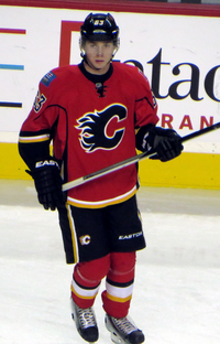 Bennett stares down the ice during pre-game warm-up prior to a Flames exhibition game.