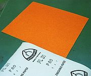 A German sandpaper showing its backing and FEPA grit size.