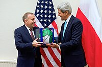 Secretary Kerry Presents Polish Foreign Minister Schetyna With a Signed Boston Celtics Basketball Before Meeting at NATO Headquarters in Belgium (15903894306)