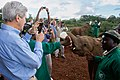 Secretary Kerry Takes Photo of Caretaker Feeding a Baby Elephant at the Sheldrick Elephant Orphanage (17358179135).jpg