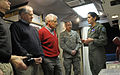 Secretary of Defense Chuck Hagel, center, listens as U.S. Air Force Capt. Erin Gentile, right, a missile combat crew commander, describes her duties in the launch control center during a visit to the missile 140109-D-NI589-898.jpg