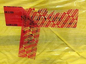 Security tape - Delamination and printing exposure of a security tape on a pallet load