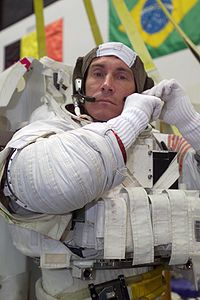 Sergei Krikalev dons a training space suit.jpg