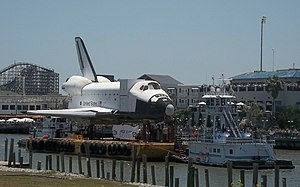 Space Shuttle Independence - Tugboats take Explorer into Clear Lake from Galveston Bay
