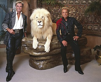 Siegfried & Roy - Roy (left) and Siegfried with their white lion