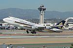 Singapore Airlines, Boeing 747-400, 9V-SMZ (16699733420).jpg