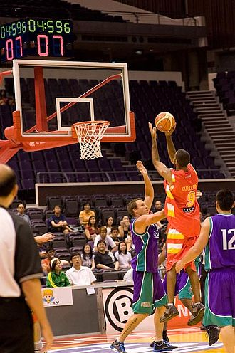 Singapore Slingers - Armein Kirkland (in red) shooting for two points against the Darwin All Stars in the Singapore Challenge in December 2008.