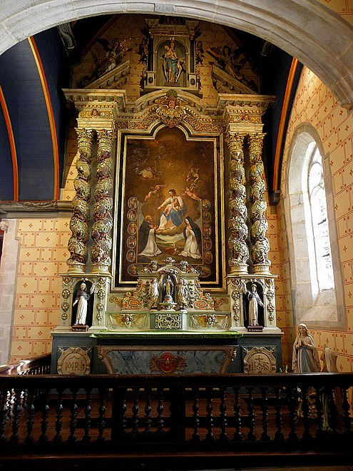 "The ""rosary"" altarpiece. The altar of the Holy Rosary has two twisted columns that frame a painting of the death of a dedicated Christian in the presence of Dom Michel le Nobletz, a famous Breton missionary from the 17th century. The altar has statues of Saint Peter and Saint Paul on either side as well as a statue of Saint Joseph at the top."