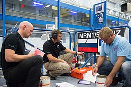 Soyuz TMA-13M crew during an emergency scenario training session at JSC.jpg
