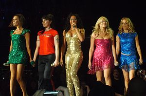 Mel B - Brown (centre) performing with the Spice Girls.