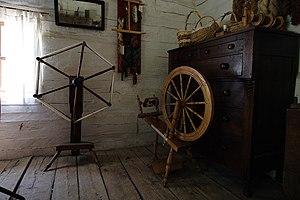 Spinner's weasel - Spinner's weasel (left) and spinning wheel (right)