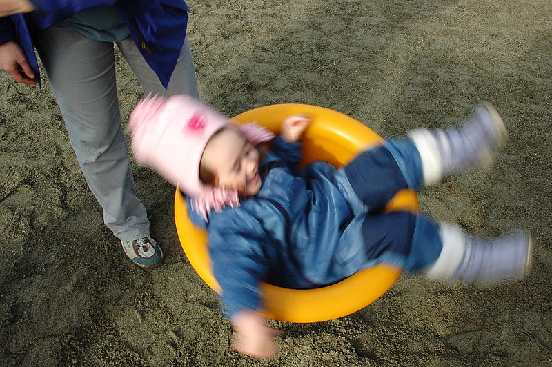 File:Spinning seat in playground.jpg