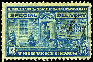 1944 13c Special Delivery stamp, showing a let...