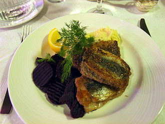 Finnish cuisine - Fried Baltic herring is a popular and wholesome Finnish dish. It is usually accompanied with boiled or mashed potatoes.