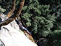 Steep rock with water falling - panoramio.jpg