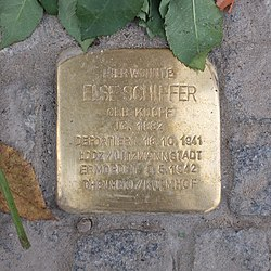 Photo of Else Schiffer brass plaque