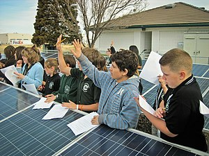 Student on a field trip, studying photovoltaic solar panels.jpg